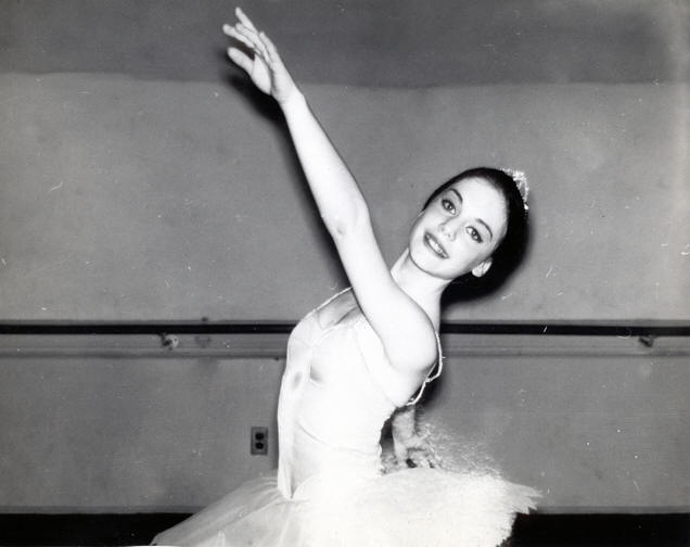 Audrey London Novoa in ballet second arabesque arms